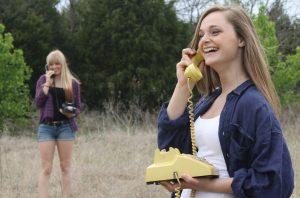 image of girls talking on old analogue phones