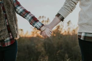 couple holding hands, only arms are visible